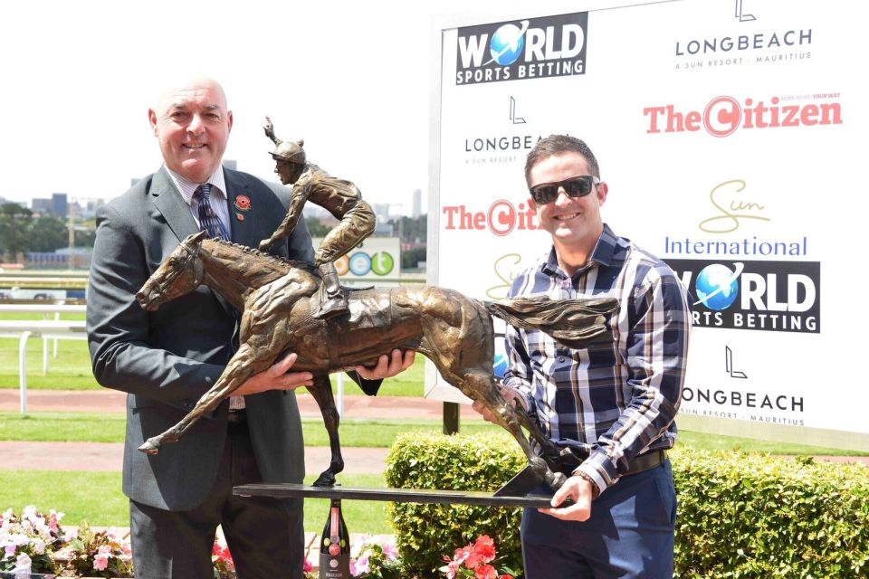 Mathew de Kock receives Monaco Maiden Sprint trophy from Bruce Grobbelaar.