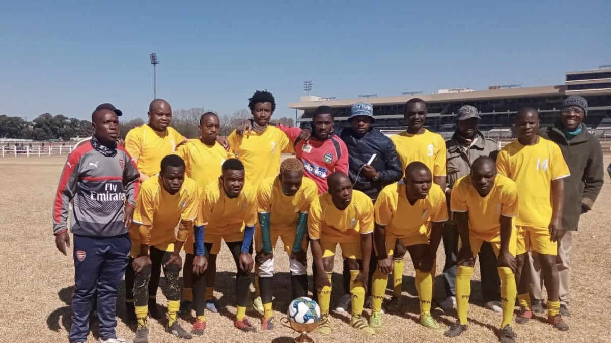 The MDK soccer team, coached by Vengi Masawi (left).